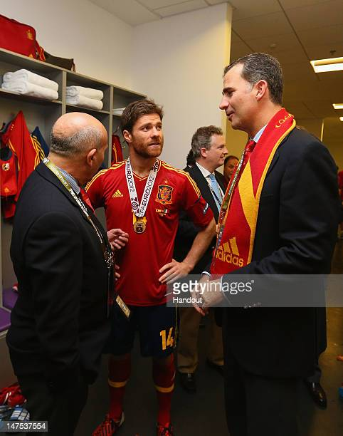 Prince Felipe of Spain speaks with Xabi Alonso of Spain in the dressing room following the UEFA EURO 2012 final match between Spain and Italy at the...