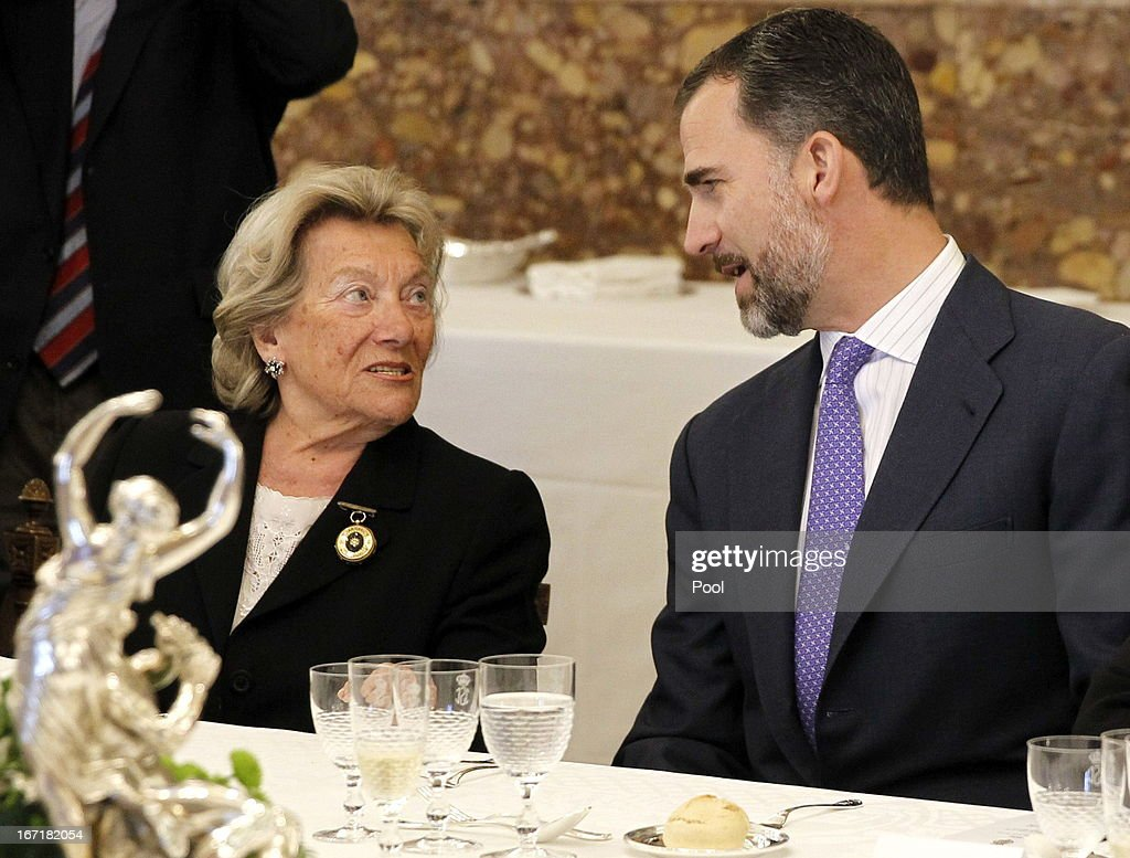 Prince Felipe of Spain talks to Pepa Ramis, wife of Spanish author and award winner Jose Manuel Caballero Bonald, during a lunch at the '2013 Cervantes Award' at the Royal Palace on April 22, 2013 in Madrid, Spain.