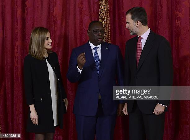 Prince Felipe VI of Spain Spanish Queen Letizia pose with Senegalese President Macky Sall at the Royal Palace in Madrid on December 15 2014 AFP...