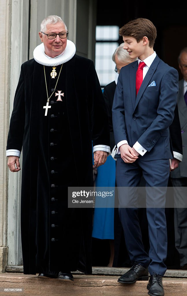 Prince Felix of Denmark, son of Prince Joachim and former wife Countess Alexandra, and Royal Priest Erik Norman Svendsen at the Fredensborg Palace church after his confirmation on April 1, 2017 in Fredensborg, Denmark. Prince Felix is 14 years old and number 8 in succession to the throne.