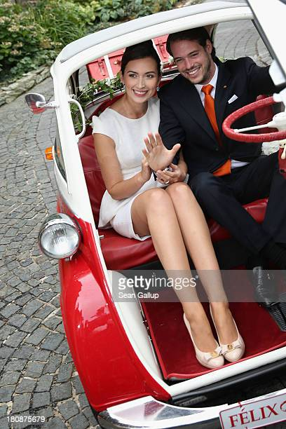 Prince Felix Of Luxembourg and Princess Claire of Luxembourg depart in the Italiandesigned BMW Isetta 300 microcar after their Civil Wedding Ceremony...