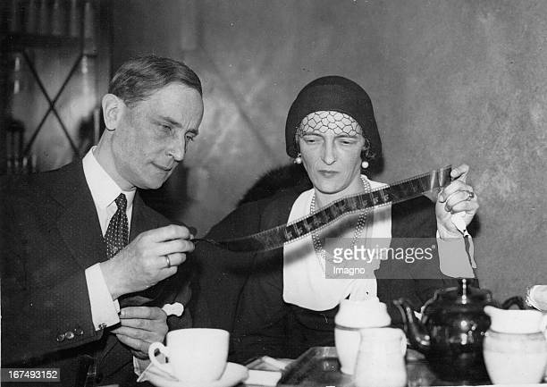 Prince Felix Yusupov and his wife Princess Irina Alexandrovna of Russia examine a film strip of film Rasputin the Mad Monk 6th March 1934 Photograph...