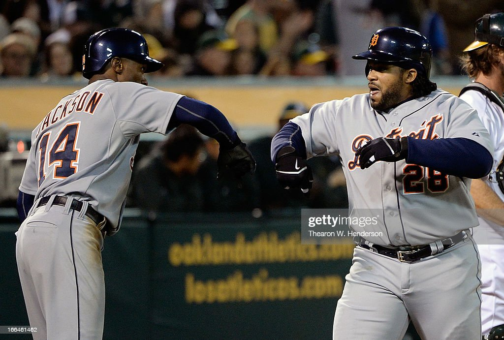 <a gi-track='captionPersonalityLinkClicked' href=/galleries/search?phrase=Prince+Fielder&family=editorial&specificpeople=209392 ng-click='$event.stopPropagation()'>Prince Fielder</a> #28 and <a gi-track='captionPersonalityLinkClicked' href=/galleries/search?phrase=Austin+Jackson&family=editorial&specificpeople=608633 ng-click='$event.stopPropagation()'>Austin Jackson</a> #14 of the Detroit Tigers celebrates after Fielder hit a three-run home run against the Oakland Athletics in the third inning at O.co Coliseum on April 12, 2013 in Oakland, California.