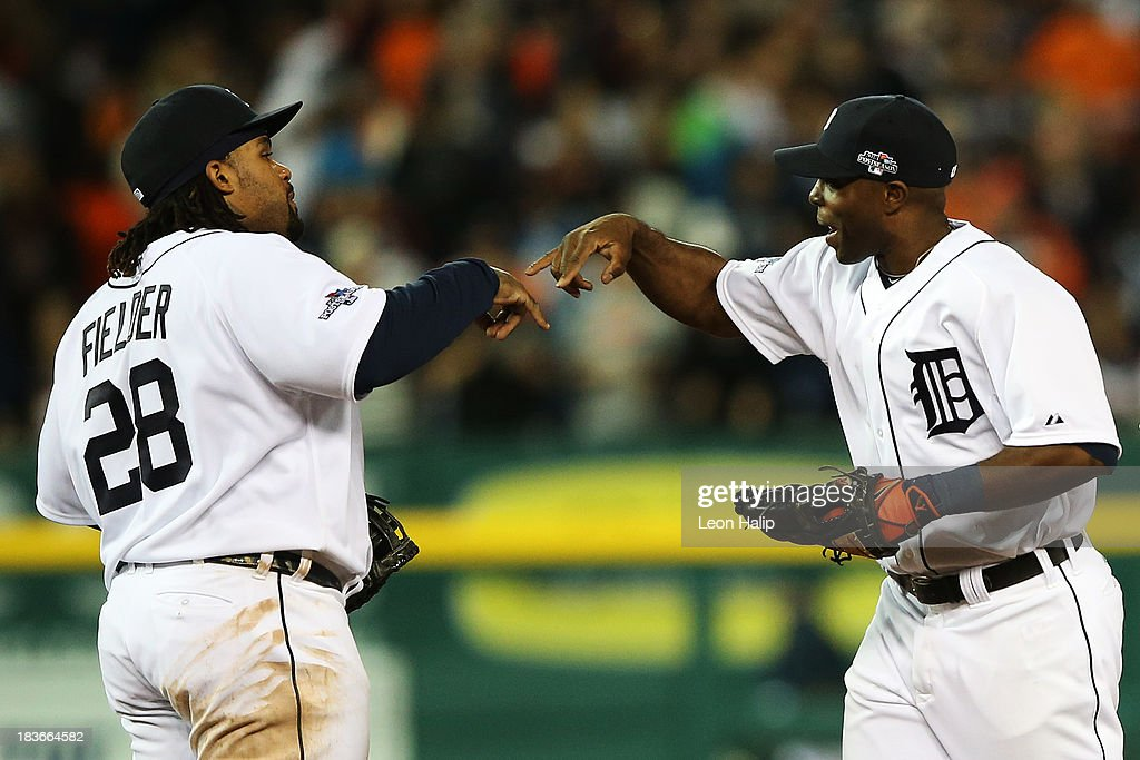 Prince Fielder #28 and Torii Hunter #48 of the Detroit Tigers celebrate their 8 to 6 win ove rthe Oakland Athletics during Game Four of the American League Division Series at Comerica Park on October 8, 2013 in Detroit, Michigan.
