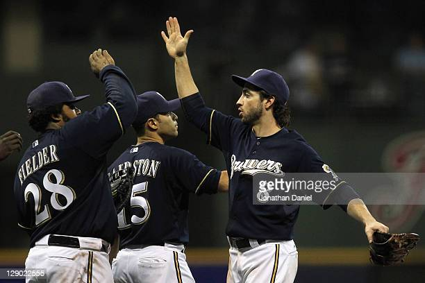 Prince Fielder Jerry Hairston Jr #15 and Ryan Braun of the Milwaukee Brewers celebrate after they won 96 against the St Louis Cardinals during Game...