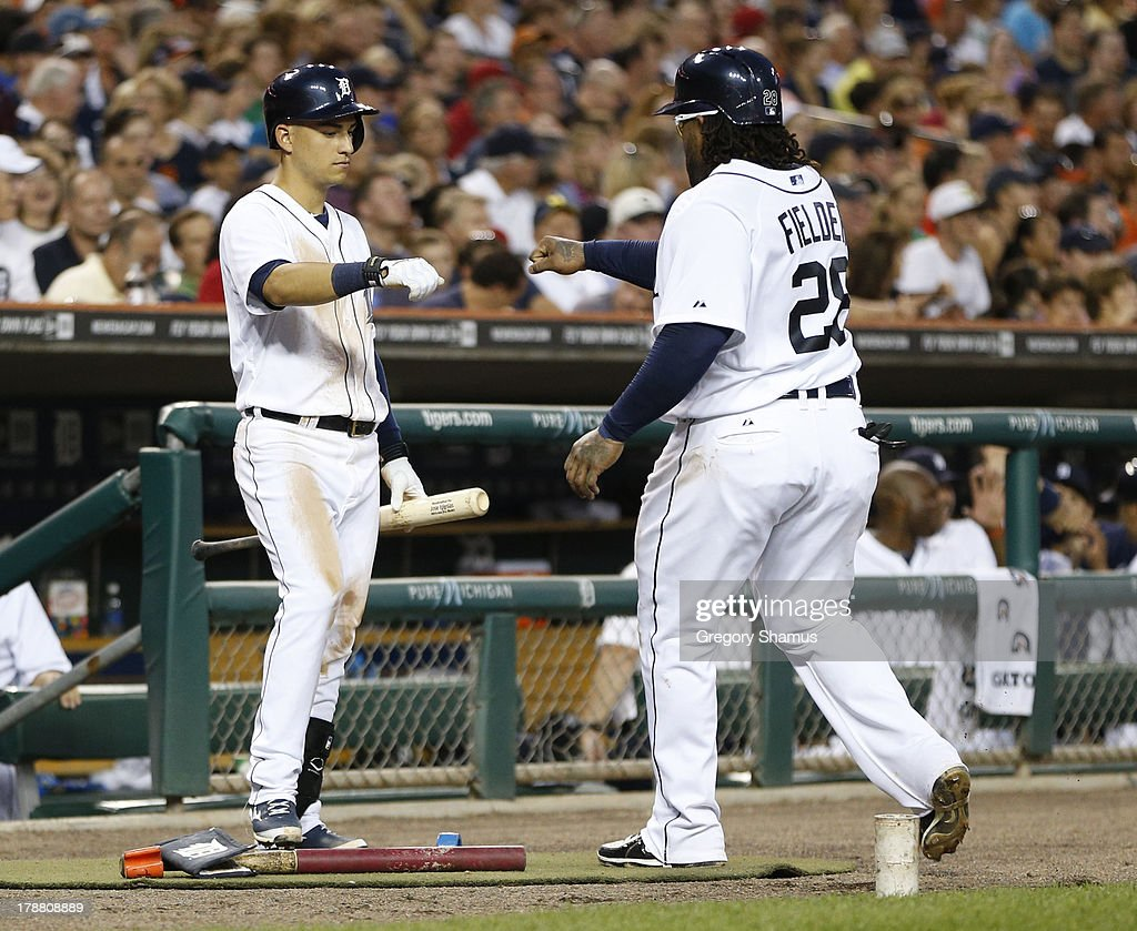 <a gi-track='captionPersonalityLinkClicked' href=/galleries/search?phrase=Prince+Fielder&family=editorial&specificpeople=209392 ng-click='$event.stopPropagation()'>Prince Fielder</a> #28 of the Detroit Tigers celebrates scoring a third inning run with Jose Igleslas #1 while playing the Cleveland Indians at Comerica Park on August 30, 2013 in Detroit, Michigan.