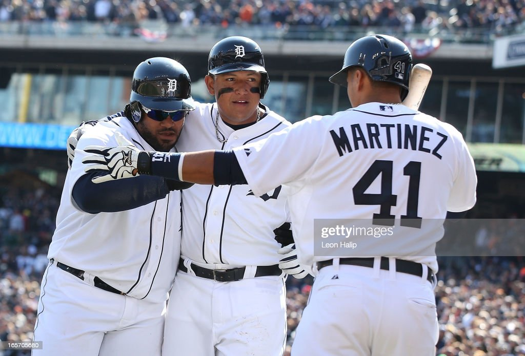 Prince Fielder #28 of the Detroit Tigers celebrates with teammate Miguel Cabrera #24 and Victor Martinez #41 after hitting a two run home run in the seventh inning during the game against the New York Yankees at Comerica Park on April 5, 2013 in Detroit, Michigan.