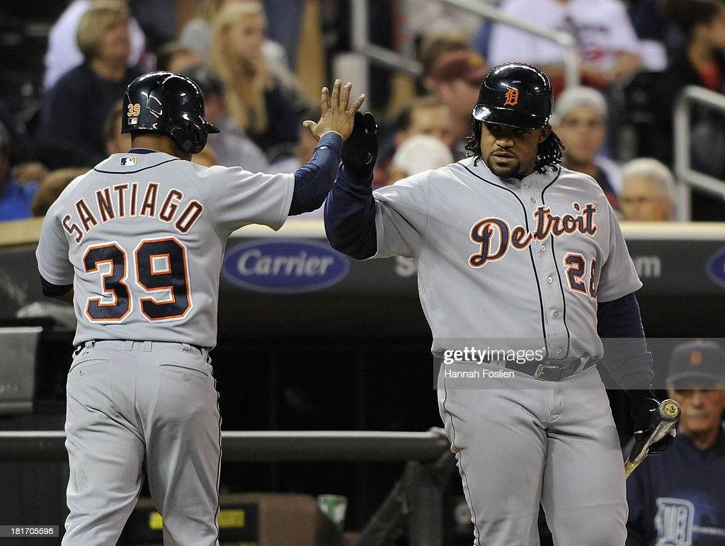 <a gi-track='captionPersonalityLinkClicked' href=/galleries/search?phrase=Prince+Fielder&family=editorial&specificpeople=209392 ng-click='$event.stopPropagation()'>Prince Fielder</a> #28 of the Detroit Tigers congratulates teammate <a gi-track='captionPersonalityLinkClicked' href=/galleries/search?phrase=Ramon+Santiago&family=editorial&specificpeople=2984417 ng-click='$event.stopPropagation()'>Ramon Santiago</a> #39 on scoring a run against the Minnesota Twins during the fifth inning of the game on September 23, 2013 at Target Field in Minneapolis, Minnesota.