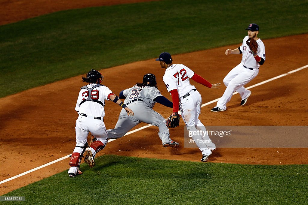 Prince Fielder of the Detroit Tigers falls to the ground and gets tagged out by Jarrod Saltalamacchia of the Boston Red Sox in the sixth inning...