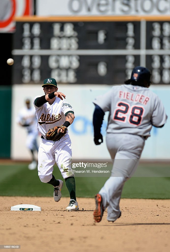 <a gi-track='captionPersonalityLinkClicked' href=/galleries/search?phrase=Prince+Fielder&family=editorial&specificpeople=209392 ng-click='$event.stopPropagation()'>Prince Fielder</a> #28 of the Detroit Tigers gets out of the way of <a gi-track='captionPersonalityLinkClicked' href=/galleries/search?phrase=Eric+Sogard&family=editorial&specificpeople=6796459 ng-click='$event.stopPropagation()'>Eric Sogard</a> #28 of the Oakland Athletics as Sogard gets his throw off to complete the double play in the fifth inning as at O.co Coliseum on April 13, 2013 in Oakland, California.