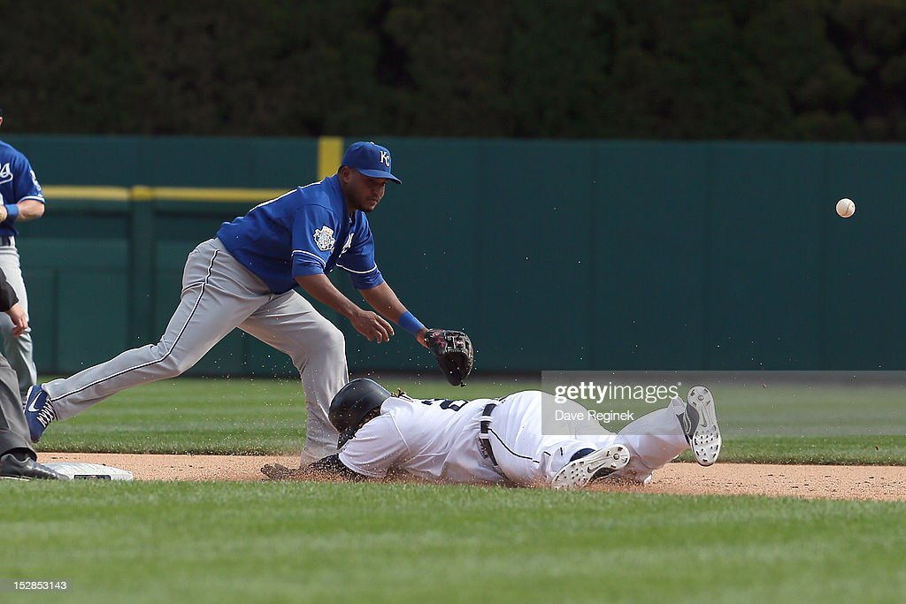 Prince Fielder #28 of the Detroit Tigers hits a double to lead off the bottom of the ninth inning and slides head first into second base in front of Alcides Escobar #2 of the Kansas City Royals during an MLB game at Comerica Park on September 27, 2012 in Detroit, Michigan.