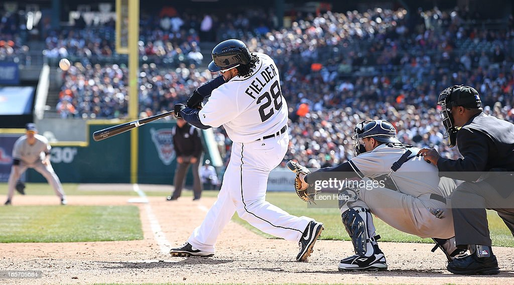 Prince Fielder #28 of the Detroit Tigers hits a two run home run in the seventh inning scoring <a gi-track='captionPersonalityLinkClicked' href=/galleries/search?phrase=Miguel+Cabrera&family=editorial&specificpeople=202141 ng-click='$event.stopPropagation()'>Miguel Cabrera</a> #24 during the game against the New York Yankees at Comerica Park on April 5, 2013 in Detroit, Michigan.