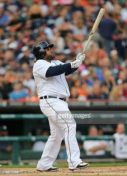Prince Fielder of the Detroit Tigers hits a two run home run in the first inning scoring Andy Dirks during the first inning of the game against the...