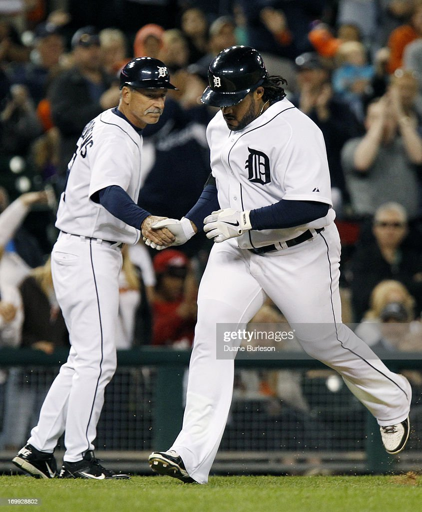 Prince Fielder #28 of the Detroit Tigers is congratulated by third base coach Tom Brookens after hitting a solo home run against the Tampa Bay Rays at Comerica Park on June 4, 2013 in Detroit, Michigan. The Tigers defeated the Rays 10-1.