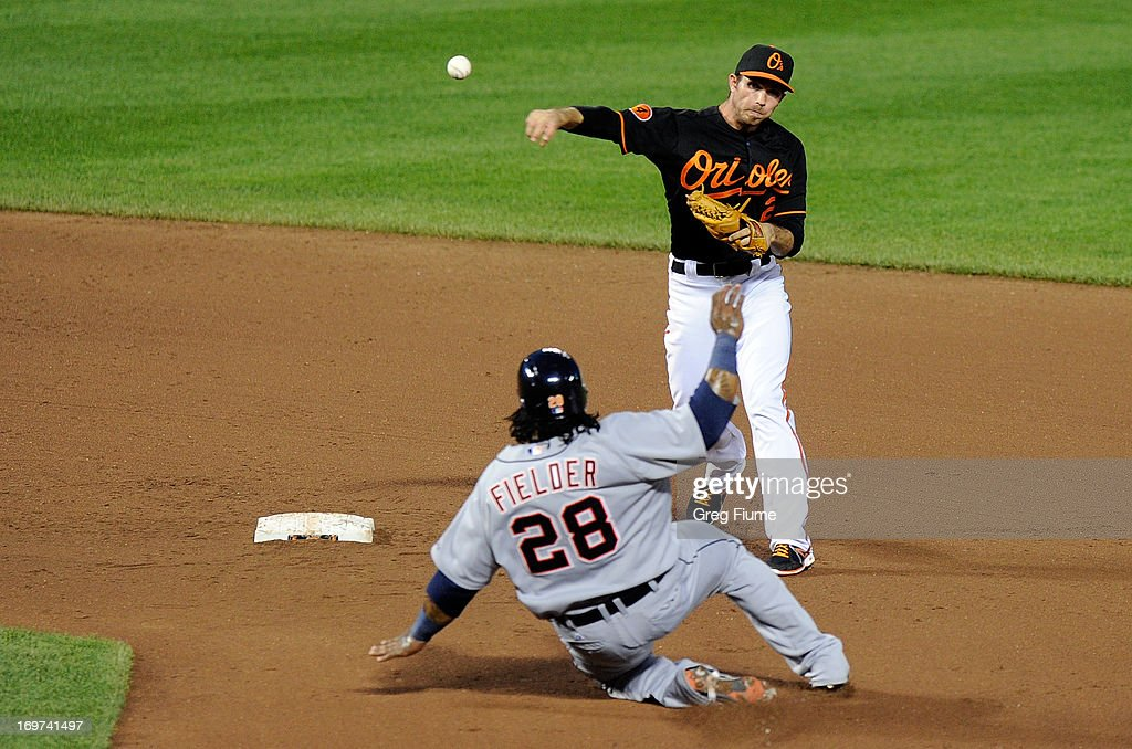 <a gi-track='captionPersonalityLinkClicked' href=/galleries/search?phrase=Prince+Fielder&family=editorial&specificpeople=209392 ng-click='$event.stopPropagation()'>Prince Fielder</a> #28 of the Detroit Tigers is forced out at second base in the fifth inning by <a gi-track='captionPersonalityLinkClicked' href=/galleries/search?phrase=J.J.+Hardy&family=editorial&specificpeople=216446 ng-click='$event.stopPropagation()'>J.J. Hardy</a> #2 of the Baltimore Orioles at Oriole Park at Camden Yards on May 31, 2013 in Baltimore, Maryland.