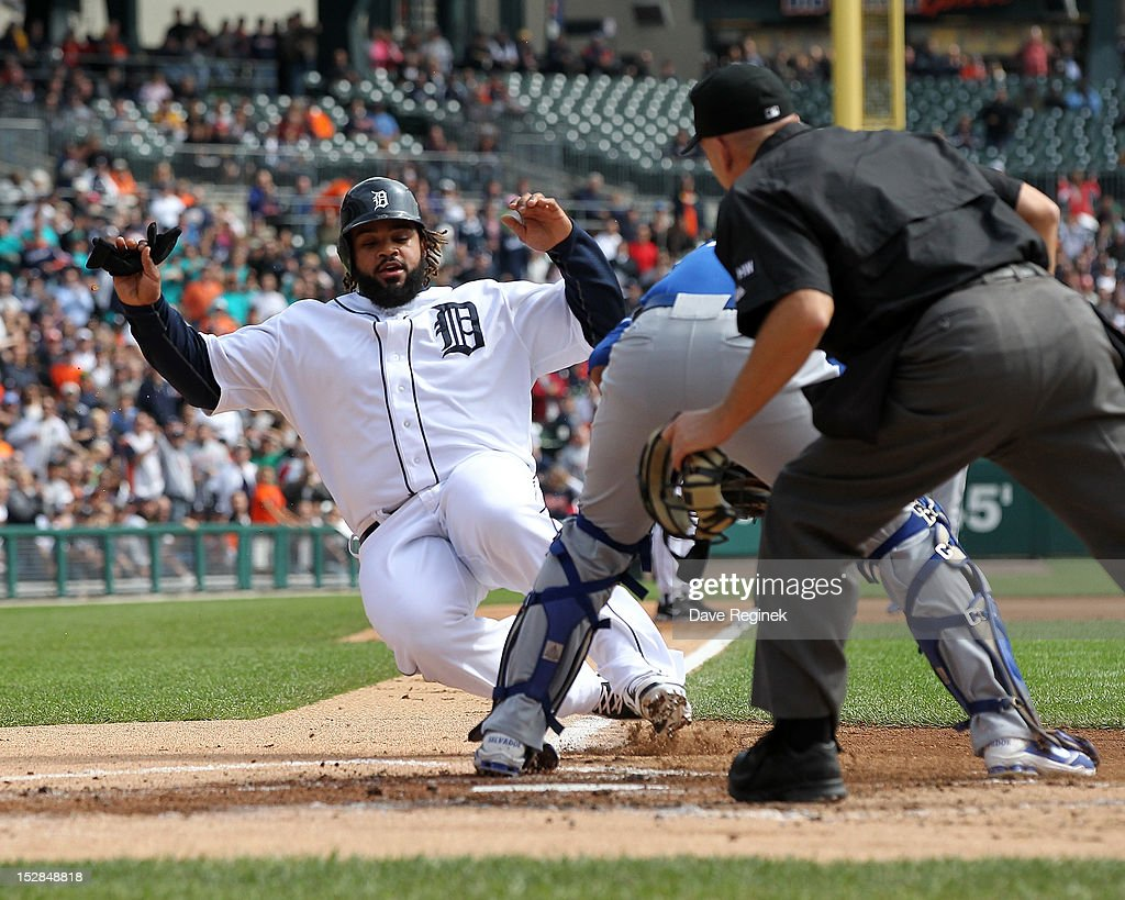 Prince Fielder #28 of the Detroit Tigers is tagged out at home plate by Salvador Perez #13 of the Kansas City Royals during an MLB game at Comerica Park on September 27, 2012 in Detroit, Michigan.
