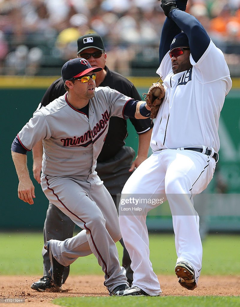 <a gi-track='captionPersonalityLinkClicked' href=/galleries/search?phrase=Prince+Fielder&family=editorial&specificpeople=209392 ng-click='$event.stopPropagation()'>Prince Fielder</a> #28 of the Detroit Tigers is tagged out at second base by <a gi-track='captionPersonalityLinkClicked' href=/galleries/search?phrase=Brian+Dozier&family=editorial&specificpeople=7553002 ng-click='$event.stopPropagation()'>Brian Dozier</a> #2 after trying to stretch a single into a double during the second inning of the game at at Comerica Park on August 22, 2013 in Detroit, Michigan. The Twins defeated the Tigers 7-6.