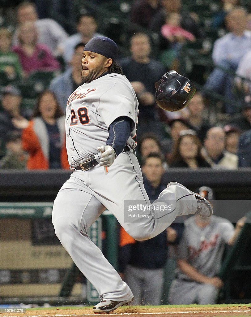 Prince Fielder #28 of the Detroit Tigers scores the tying run in the eighth inning on a single by Victor Martinez #41 of the Detroit Tigers at Minute Maid Park on May 2, 2013 in Houston, Texas.