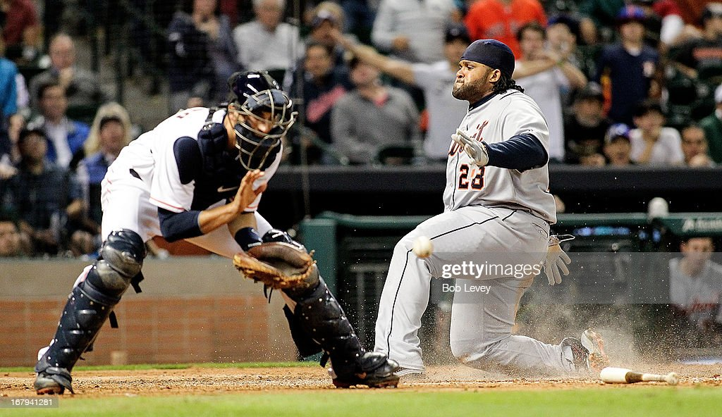 Prince Fielder #28 of the Detroit Tigers scores the tying run in the eighth inning on a single by Victor Martinez #41 of the Detroit Tigers as catcher Jason Castro #15 of the Houston Astros waits for the ball at Minute Maid Park on May 2, 2013 in Houston, Texas.