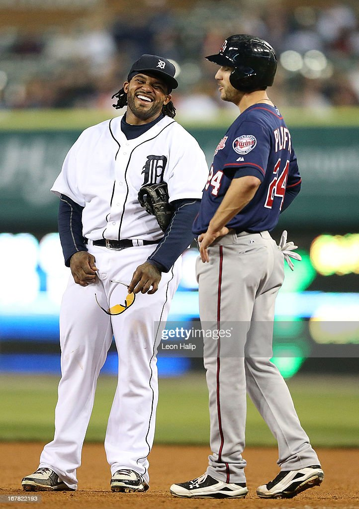 <a gi-track='captionPersonalityLinkClicked' href=/galleries/search?phrase=Prince+Fielder&family=editorial&specificpeople=209392 ng-click='$event.stopPropagation()'>Prince Fielder</a> #28 of the Detroit Tigers shares a laugh with <a gi-track='captionPersonalityLinkClicked' href=/galleries/search?phrase=Trevor+Plouffe&family=editorial&specificpeople=5722348 ng-click='$event.stopPropagation()'>Trevor Plouffe</a> #24 of the Minnesota Twins during the game at Comerica Park on April 30, 2013 in Detroit, Michigan. The Tigers defeated the Twins 6-1.