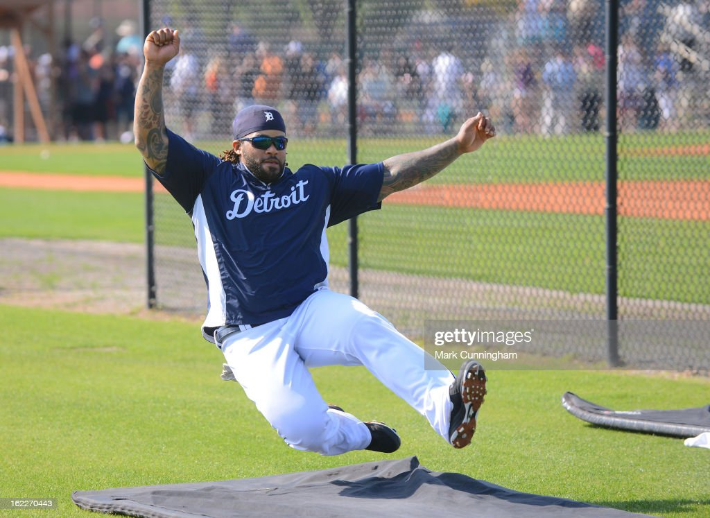 Prince Fielder #28 of the Detroit Tigers slides during a drill in Spring Training workouts at the TigerTown Facility on February 21, 2013 in Lakeland, Florida.