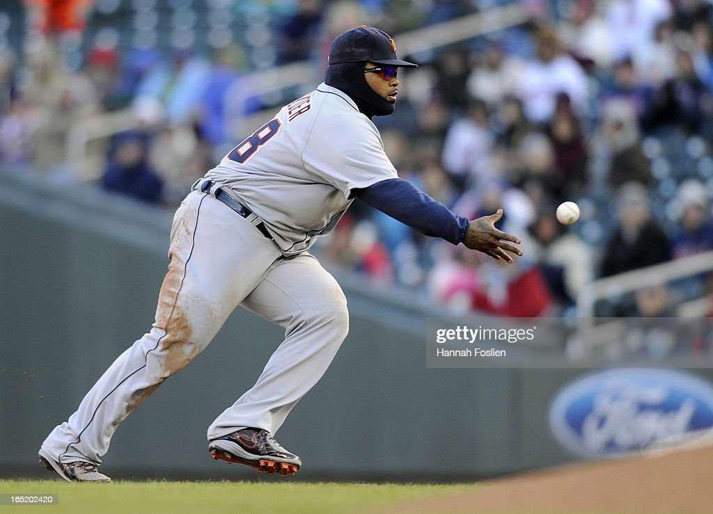 <a gi-track='captionPersonalityLinkClicked' href=/galleries/search?phrase=Prince+Fielder&family=editorial&specificpeople=209392 ng-click='$event.stopPropagation()'>Prince Fielder</a> #28 of the Detroit Tigers throws to ball to Joaquin Benoit #53 at first base during the eighth inning of the Opening Day game against the Minnesota Twins on April 1, 2013 at Target Field in Minneapolis, Minnesota. The Tigers defeated the Twins 4-2.