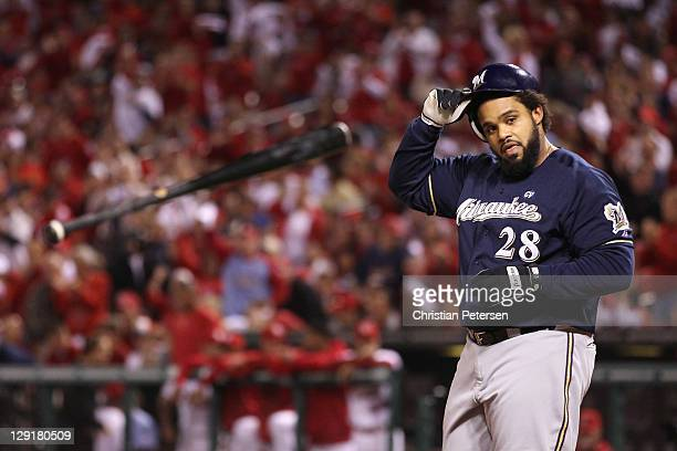 Prince Fielder of the Milwaukee Brewers throws his bat after he struck out in the top of the first inning against the St Louis Cardinals during Game...