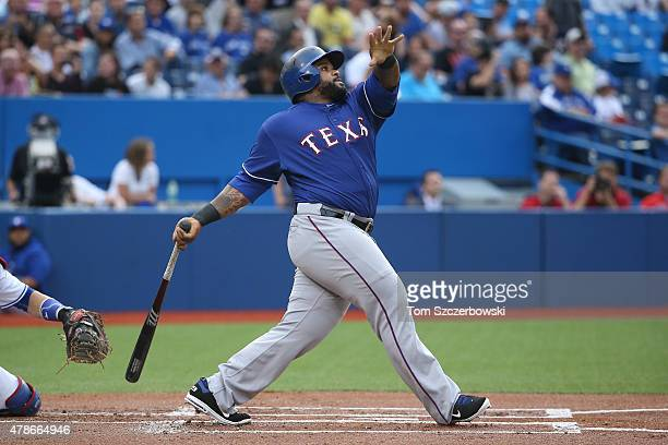 Prince Fielder of the Texas Rangers hits his 300th career home run in the first inning during MLB game action against the Toronto Blue Jays on June...