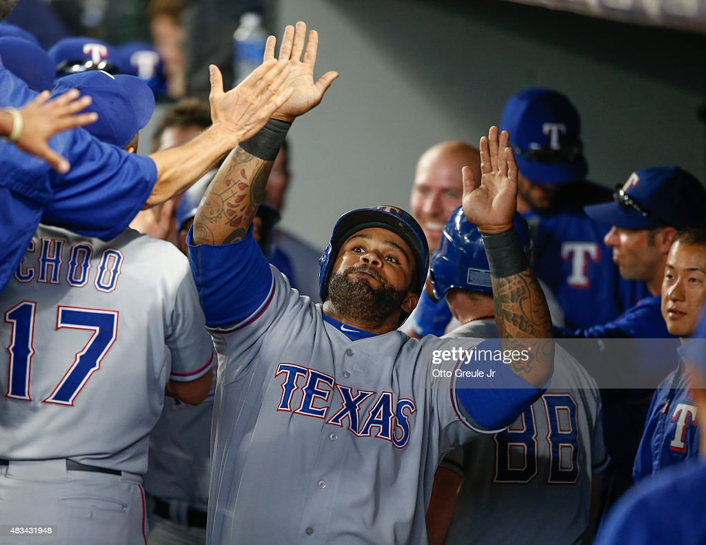 <a gi-track='captionPersonalityLinkClicked' href=/galleries/search?phrase=Prince+Fielder&family=editorial&specificpeople=209392 ng-click='$event.stopPropagation()'>Prince Fielder</a> #84 of the Texas Rangers is congratulated by teammates after hitting a two-run home run to take an 11-3 lead against the Seattle Mariners in the eleventh inning at Safeco Field on August 8, 2015 in Seattle, Washington.