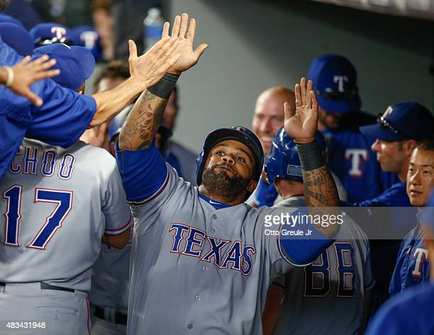 Prince Fielder of the Texas Rangers is congratulated by teammates after hitting a tworun home run to take an 113 lead against the Seattle Mariners in...