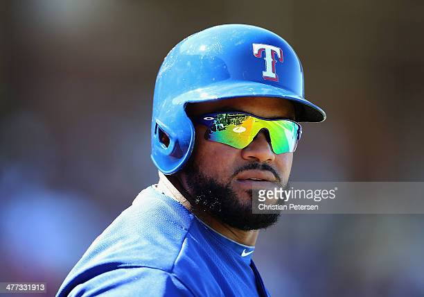 Prince Fielder of the Texas Rangers stands on deck during the spring training game against the Los Angeles Dodgers at Surprise Stadium on March 8...
