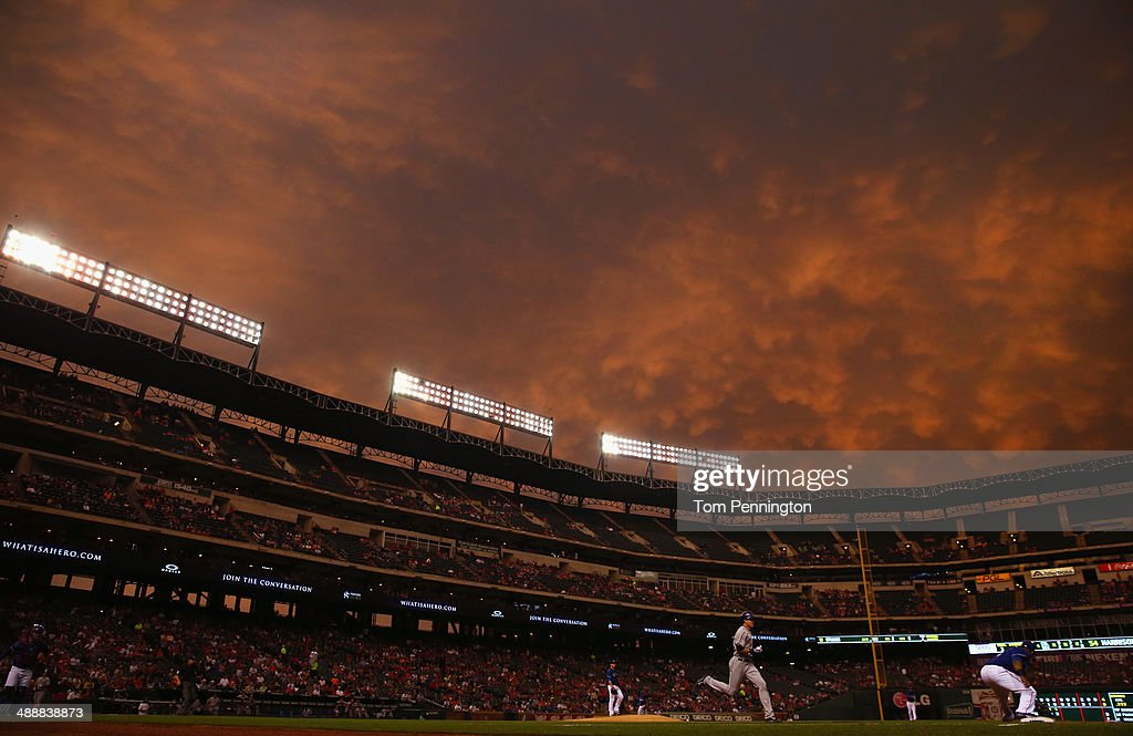 <a gi-track='captionPersonalityLinkClicked' href=/galleries/search?phrase=Prince+Fielder&family=editorial&specificpeople=209392 ng-click='$event.stopPropagation()'>Prince Fielder</a> #84 of the Texas Rangers tags out <a gi-track='captionPersonalityLinkClicked' href=/galleries/search?phrase=Drew+Stubbs+-+Baseball+Player&family=editorial&specificpeople=4498334 ng-click='$event.stopPropagation()'>Drew Stubbs</a> #13 of the Colorado Rockies in the top of the fourth inning at Globe Life Park in Arlington on May 8, 2014 in Arlington, Texas.