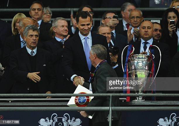 Prince Filipe of Spain shakes hands with Sir Alex Ferguson manager of Manchester United after the UEFA Champions League final between FC Barcelona...