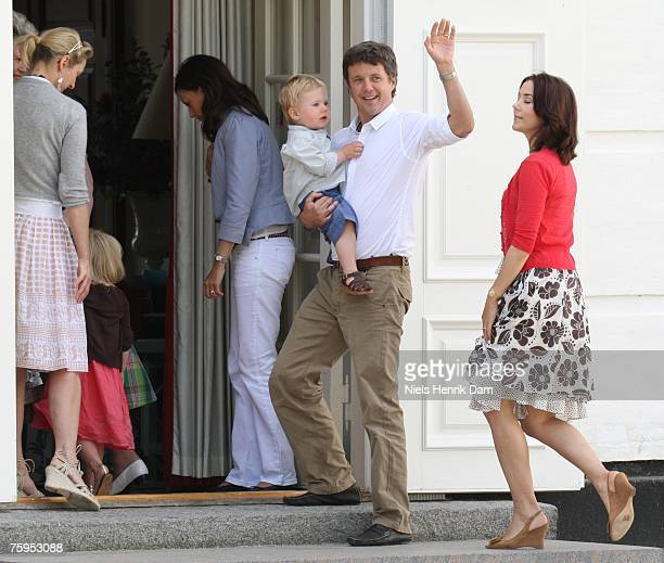 Prince Frederick of Denmark waves as he and Princess Mary of Denmark attend a photocall at their summer residence of Grasten Slot on August 3 2007 in...