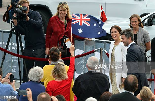 Prince Frederik and Princess Mary of Denmark smile as a women waves flag to greet them ahead of the 40th Anniversary Gala Concert for the Sydney...