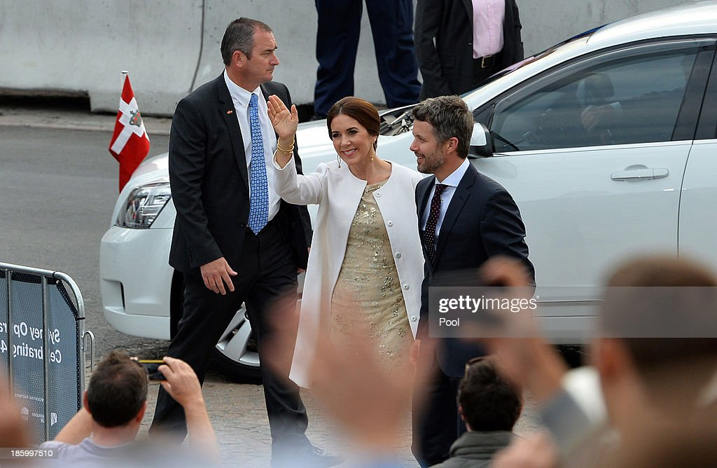 Prince Frederik and Princess Mary of Denmark wave to onlookes as they arrive for the 40th Anniversary Gala Concert for the Sydney Opera House on October 27, 2013 in Sydney, Australia. Prince Frederik and Princess Mary will visit Sydney for five days and will attend events to celebrate the 40th anniversary of the Sydney Opera House and the Danish architect who designed the landmark, Jorn Utzen.