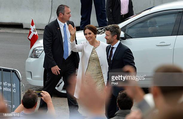 Prince Frederik and Princess Mary of Denmark wave to onlookes as they arrive for the 40th Anniversary Gala Concert for the Sydney Opera House on...
