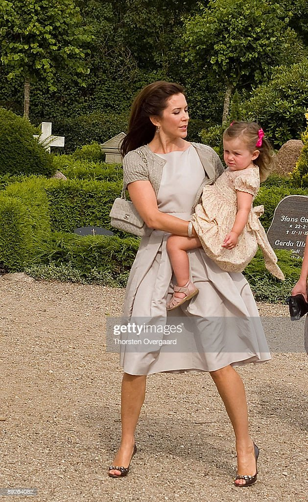 Prince Frederik and Princess Mary with Pincess Isabella and Prince Christian arrive for the Christening of Prince Henrik Carl Joachim Alain of Denmark at Mogeltonder Church on July 26, 2009 in Mogeltonder, Denmark.