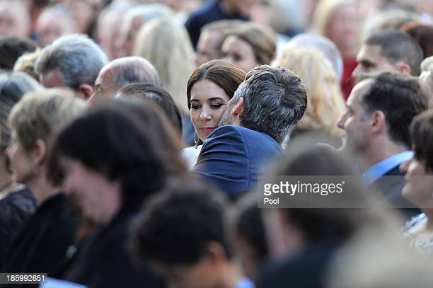 Prince Frederik kisses his wife Princess Mary of Denmark after she delivered a speech at the 40th Anniversary Gala Concert for the Sydney Opera House...
