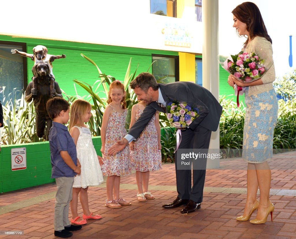 Prince Frederik of Denmark and Princess Mary of Denmark greet Kai (L), Siobhan Pereira (2nd L), Lillian (C) and Charlotte Harding (2nd R) as the royal couple arrive for a visit to the Australian Twin Registry (ATR) at the Sydney Children's Hospital on October 26, 2013 in Sydney, Australia. Prince Frederik and Princess Mary will visit Sydney for five days and will attend events to celebrate the 40th anniversary of the Sydney Opera House and the Danish architect who designed the landmark, Jorn Utzen.