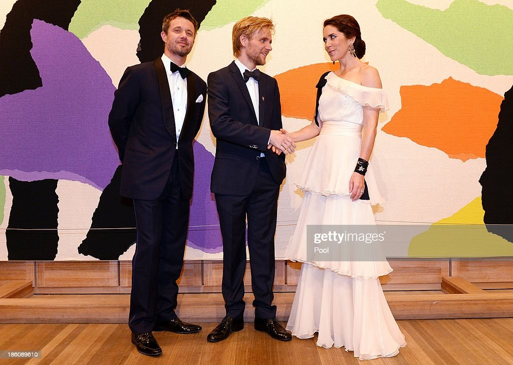 Prince Frederik of Denmark and Princess Mary of Denmark pose with violinist Rune Tonsgaard Sorensen (C), joint winner of the Rising Star Award at the Crown Prince Couple Awards 2013 held at the Sydney Opera House on October 28, 2013 in Sydney, Australia. Prince Frederik and Princess Mary are on a five day visit to Sydney and will attend events to celebrate the 40th anniversary of the Sydney Opera House and the Danish architect who designed the landmark, Jorn Utzen.