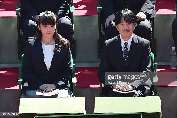 Prince Fumihito of Akishino and his first daughter Princess Mako of Akihisno watch the men's singles first round match between Joao Sousa of Portugal...