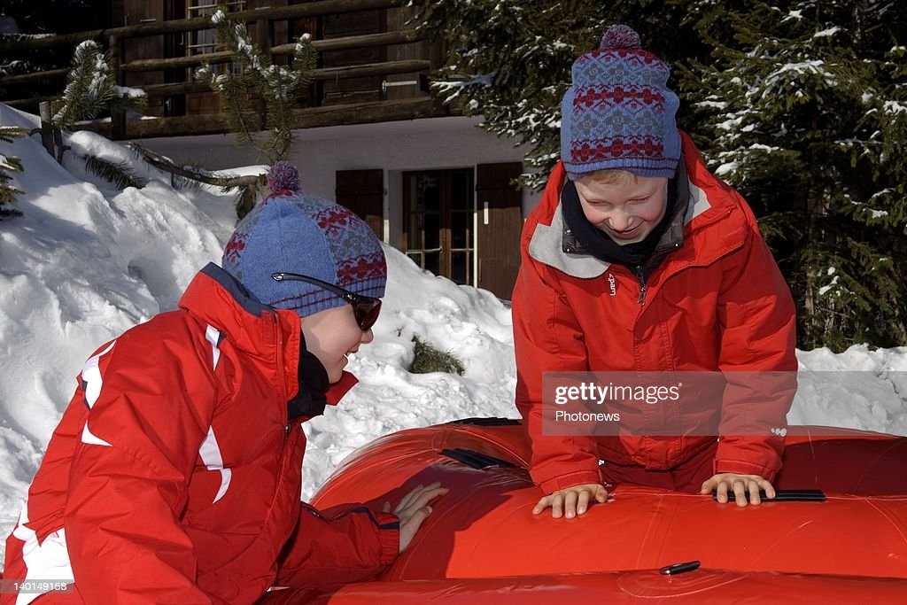 VERBIER , SWITZERLAND - FEBRUARY 22, 2012: Prince Gabriel (L) and Prince Emmanuel play on the ski slopes during the Royal Family Skiing Holiday on February 22,2012 in Verbier,Switzerland.