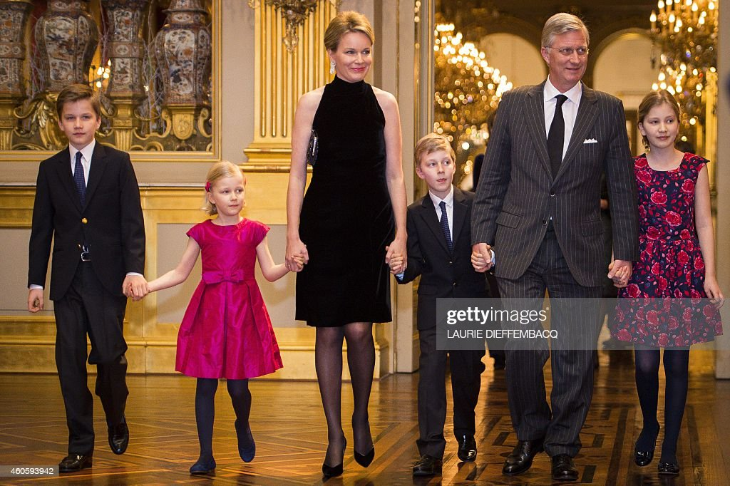 Prince Gabriel, Princess Eleonore, <a gi-track='captionPersonalityLinkClicked' href=/galleries/search?phrase=Queen+Mathilde+of+Belgium&family=editorial&specificpeople=239189 ng-click='$event.stopPropagation()'>Queen Mathilde of Belgium</a>, Prince Emmanuel, King <a gi-track='captionPersonalityLinkClicked' href=/galleries/search?phrase=Philippe+of+Belgium&family=editorial&specificpeople=160209 ng-click='$event.stopPropagation()'>Philippe of Belgium</a> and Crown Princess Elisabeth smile as they attend the yearly Christmas Concert at the Royal Palace in Brussels on December 17, 2014.