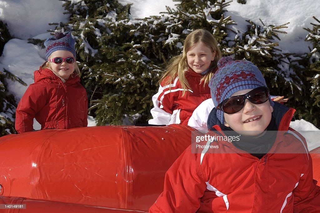 VERBIER , SWITZERLAND - FEBRUARY 22, 2012: Prince Gabriel (R) with Princess Elizabeth (C) and Princess Eleanore (L) play on the ski slopes during the Royal Family Skiing Holiday on February 22,2012 in Verbier,Switzerland.