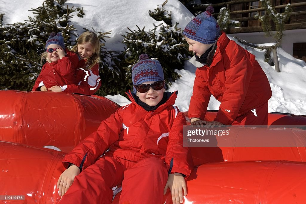 VERBIER , SWITZERLAND - FEBRUARY 22, 2012: Prince Gabriel (C) with Princess Elizabeth (L) holding Princess Eleanore and Prince Emmanuel (R) play on the ski slopes during the Royal Family Skiing Holiday on February 22,2012 in Verbier,Switzerland.