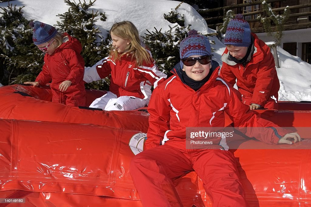 VERBIER , SWITZERLAND - FEBRUARY 22, 2012: Prince Gabriel (C) with Princess Elizabeth (2ndL) Princess Eleanore (L) and Prince Emmanuel (R) play on the ski slopes during the Royal Family Skiing Holiday on February 22,2012 in Verbier,Switzerland.