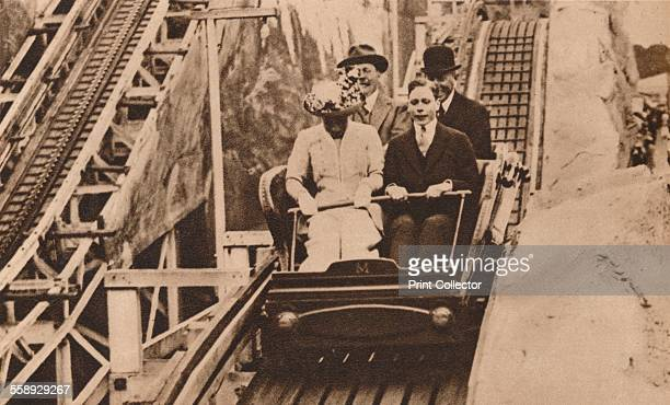 Prince George and Princess Mary enjoy the fun of the fair at the opening of Earls Court Exhibition London 1913 From The Royal Jubilee Book 19101935...