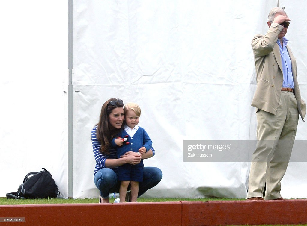 Prince George Catherine Duchess of Cambridge and Prince Charles Prince of Wales attend the Gigaset Charity Polo Match at the Beaufort Polo Club in...