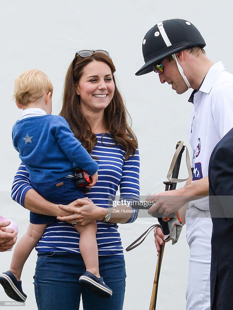 Prince George Catherine Duchess of Cambridge and Prince William Duke of Cambridge attend the Gigaset Charity Polo Match at the Beaufort Polo Club in...